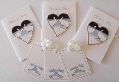 Christmas Wishes greeting with kissing hares on Heart.